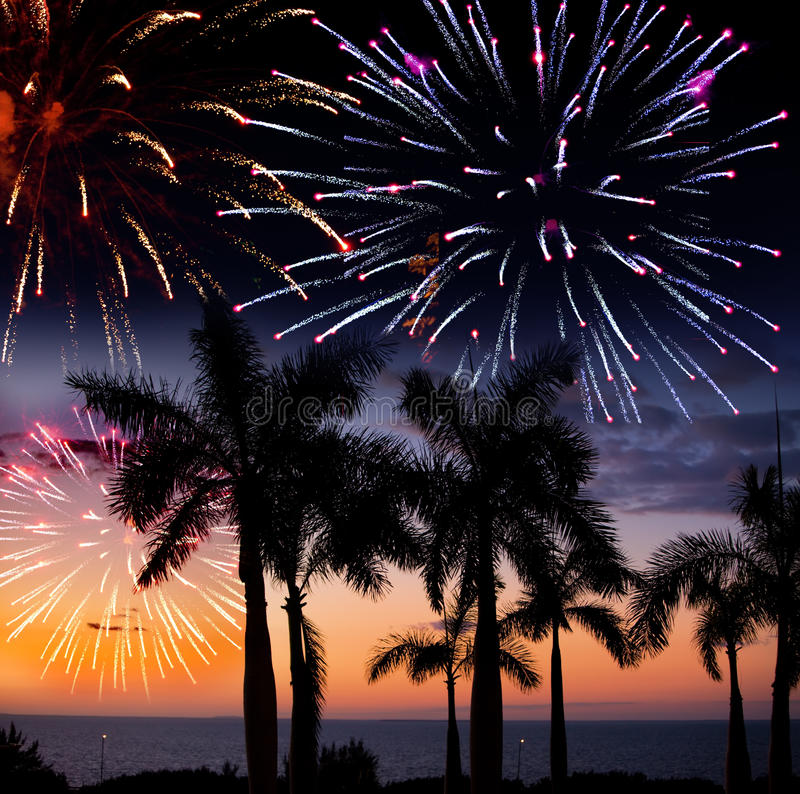 Festive New Year's fireworks over the tropical island. Night tropical landscape royalty free stock photos