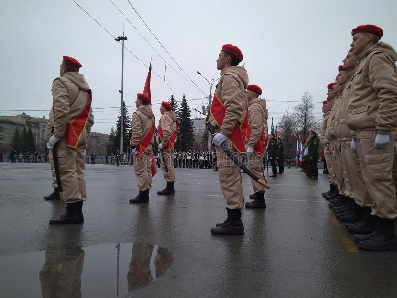Festive parade of the military in uniform on may 9 in Novosibirsk on Lenin square marching troops in uniform on the construction royalty free stock photography