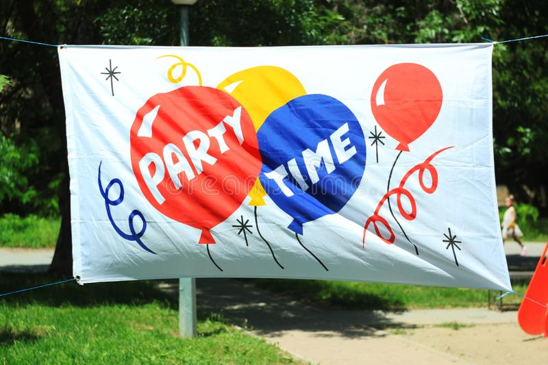 Festive Party Time banner with copy space, summer street background. stock images