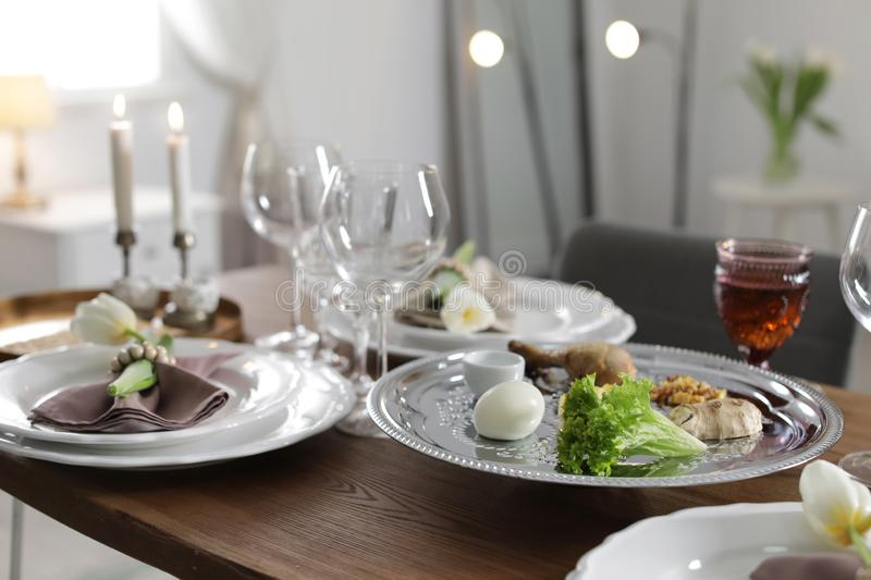Festive Passover table setting at home. Pesach celebration stock images