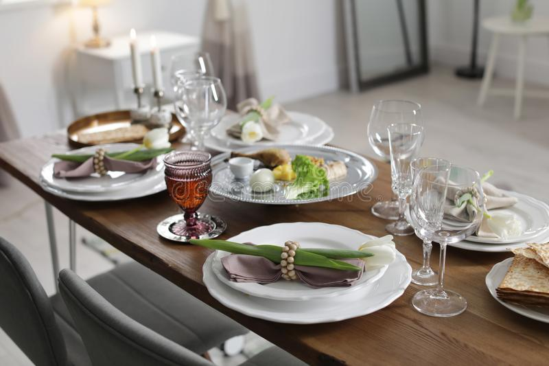 Festive Passover table setting at home. Pesach celebration stock photography