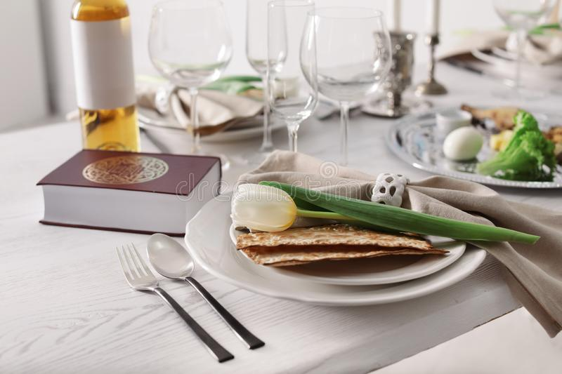 Festive Passover table setting with Torah. Pesach celebration royalty free stock image