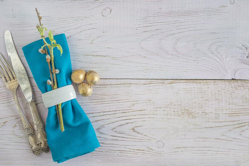 Festive place setting with willow twigs and quail eggs stock photo