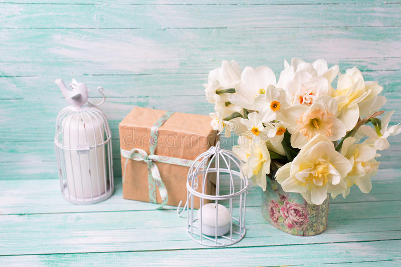 Festive present box, flowers and candles on turquoise painted w stock photo