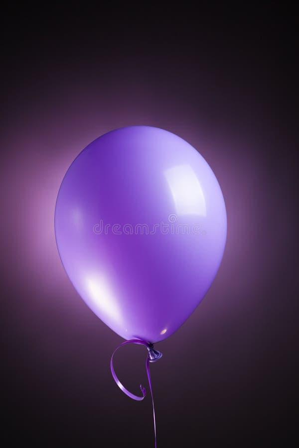 Festive purple balloon stock photos