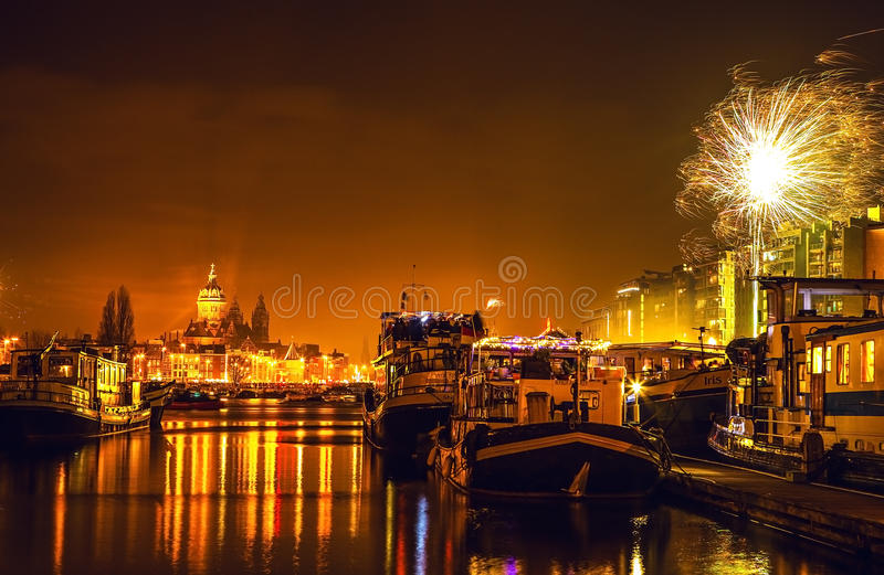 Festive salute of fireworks on New Year's night. On January 1, 2016 in Amsterdam - Netherland. AMSTERDAM, NETHERLANDS - JANUARY 1, 2016: Festive salute of royalty free stock photos