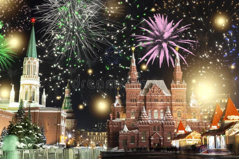 Festive salute and fireworks on the red square in Moscow. Salute lights over the Kremlin and GUM at the New Year celebration stock image