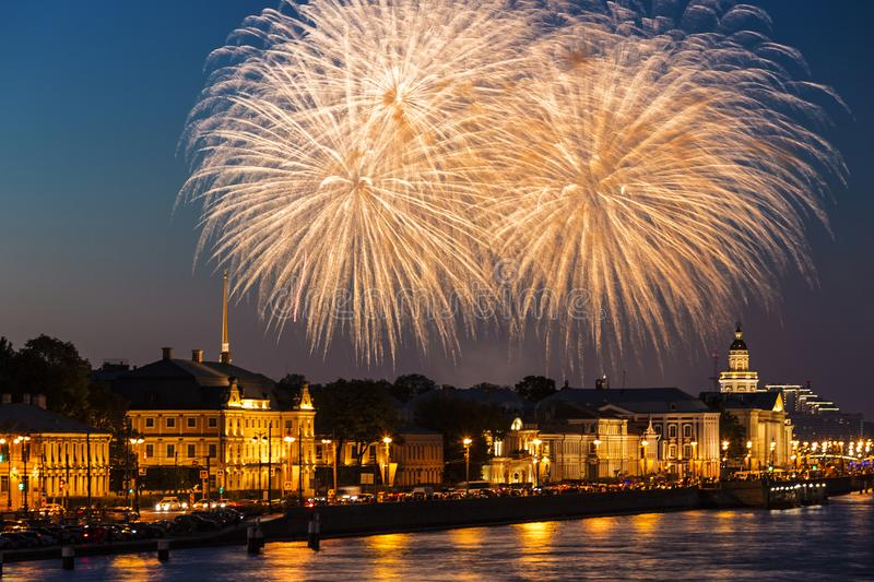 Festive salute over the University embankment on the city Day in St. Petersburg royalty free stock photo