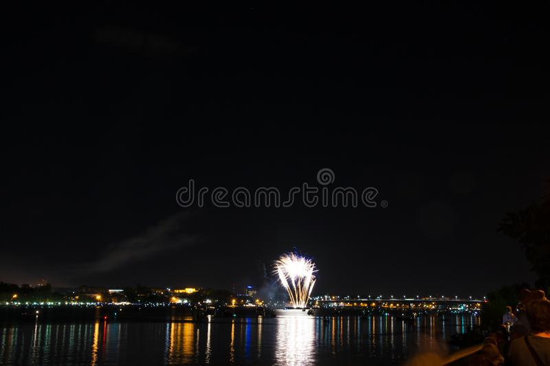 Fireworks of yellow and fireballs and blue small curls to the da stock photography