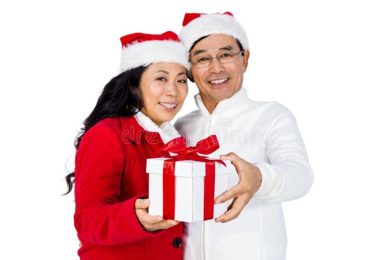 Festive senior couple exchanging gifts royalty free stock photo