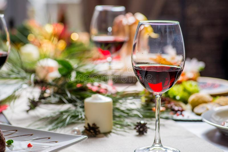 Festive served table. With food and glasses of wine royalty free stock photos