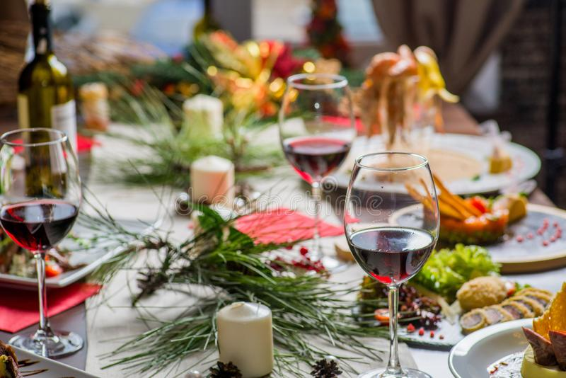 Festive served table. With food and glasses of wine royalty free stock images