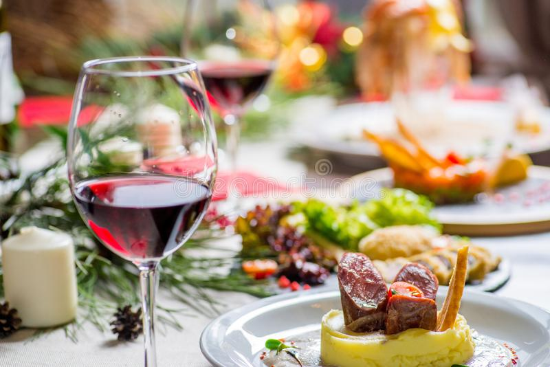 Festive served table. With food and glasses of wine stock photography