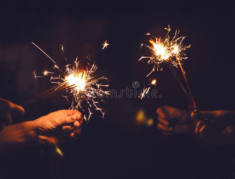 Festive sparklers burn stock photography