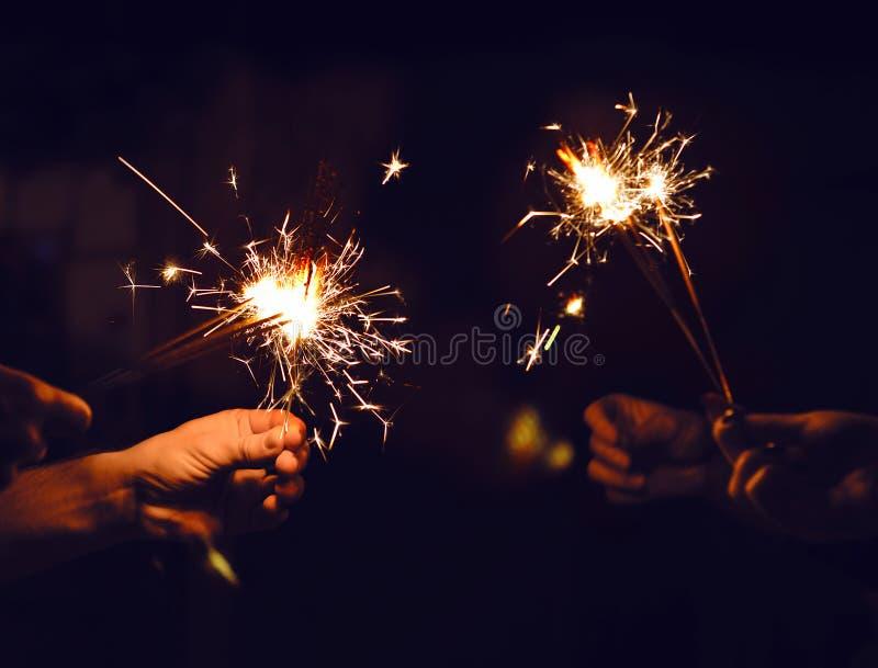 Festive sparklers burn stock images