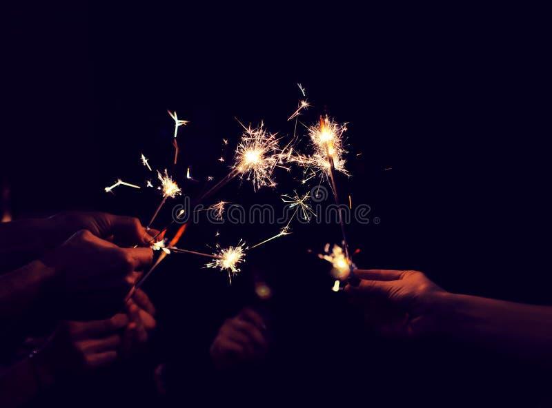 Festive sparklers burn royalty free stock photo