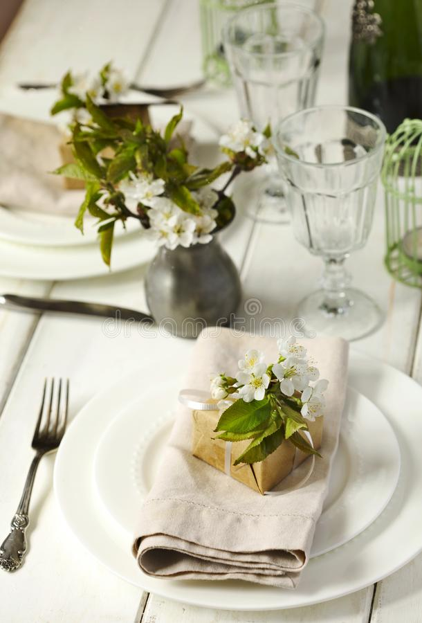 Festive spring table setting with pear blossom flowers stock images