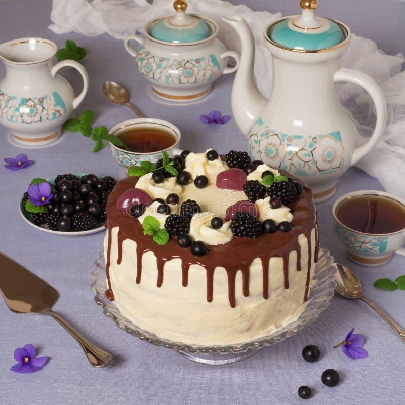Festive table, big cake, beautiful tableware, tea royalty free stock images