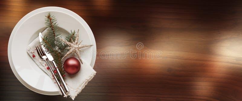 Festive table decoration for a christmas dinner stock photos
