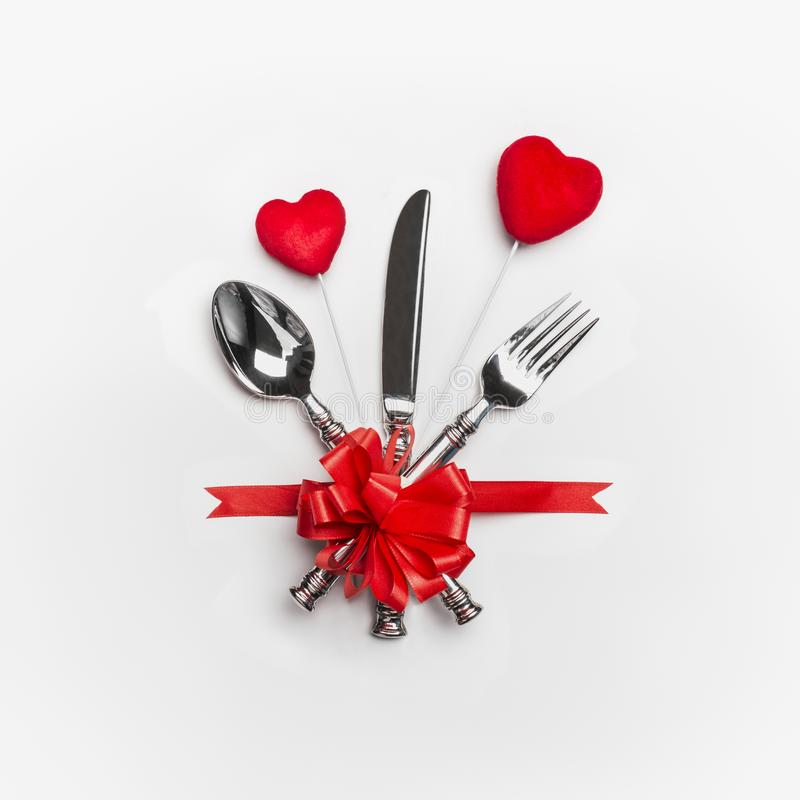 Free Festive Table Place Setting With Cutlery And Red Bow And Two Hearts On White Background. Layout For Valentines Day Dinner Stock Photo - 105323780