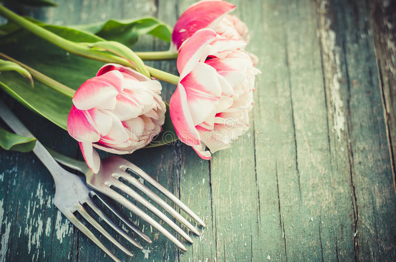 Festive Table Set for Mother`s Day or Birthday. Festive Table Setting With Pink Tulips. Holliday Table Set for Mother`s Day or Birthday. Selective Focus royalty free stock images