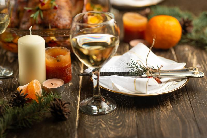 Festive table setting bowls and cutlery, glasses of wine against a background of baked duck.  royalty free stock images