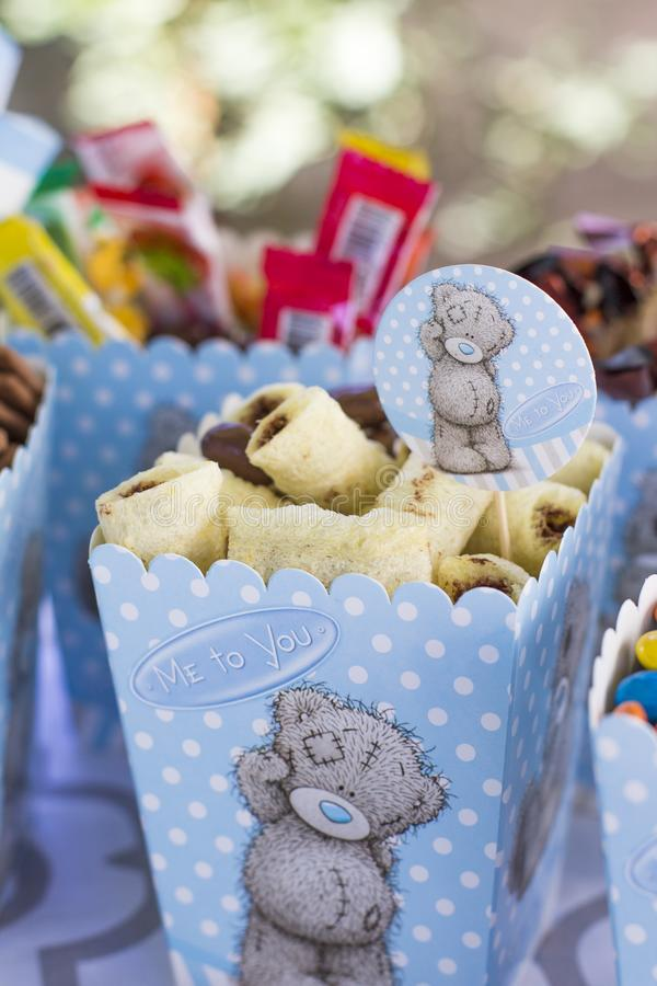 Festive table setting for children. Decoration for children`s party. Teddy bear style serving. Sweets stock photo