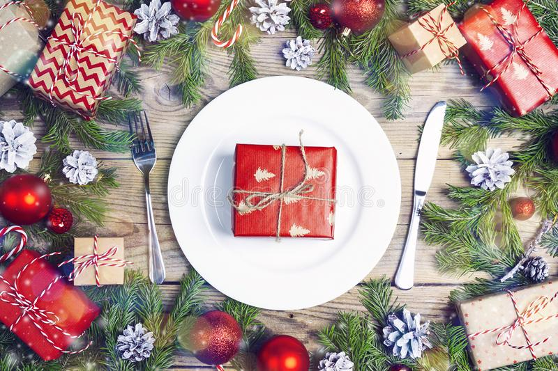 Festive table setting with cutlery, Christmas decorations and gi stock images