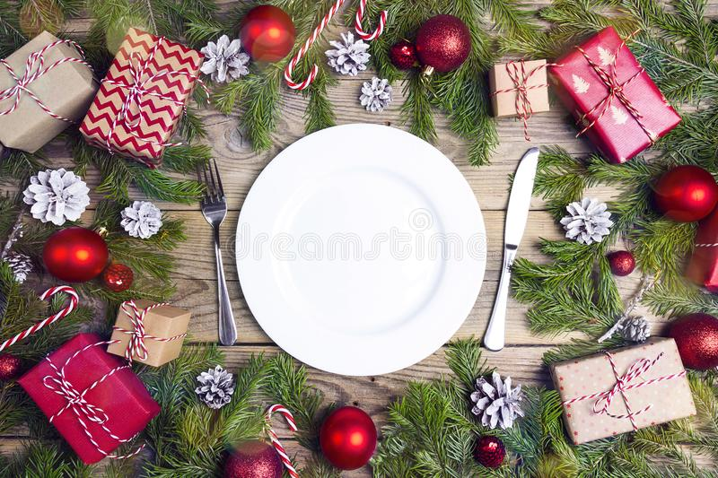 Festive table setting with cutlery and Christmas decorations on royalty free stock photos