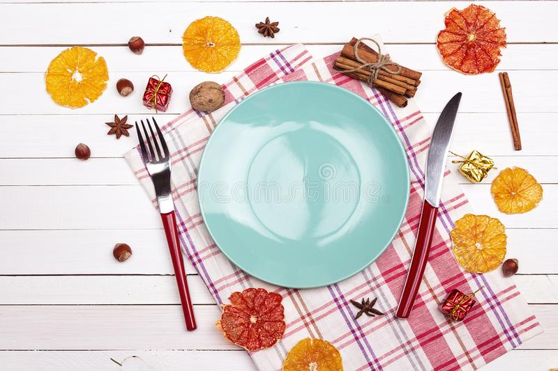 Festive table setting with cutlery, dried oranges and spices on stock image