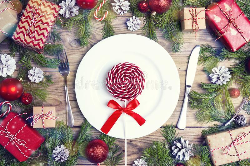 Festive table setting with cutlery, fir branches and Christmas d stock photo