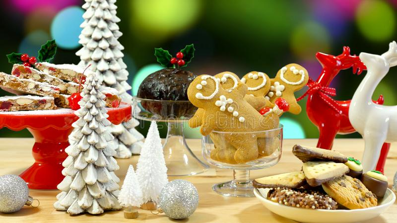 Festive table with traditional English and European style Christmas food. Festive table with traditional English and European style Christmas food including stock photos