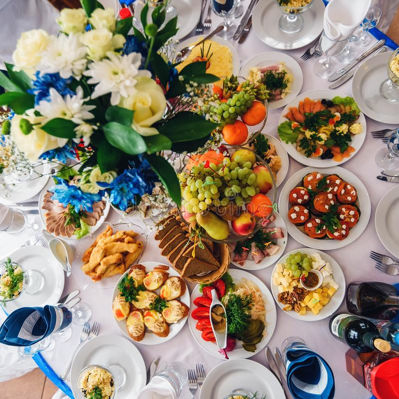 Festive table with variety of food and drinks for festive event and dinner royalty free stock images