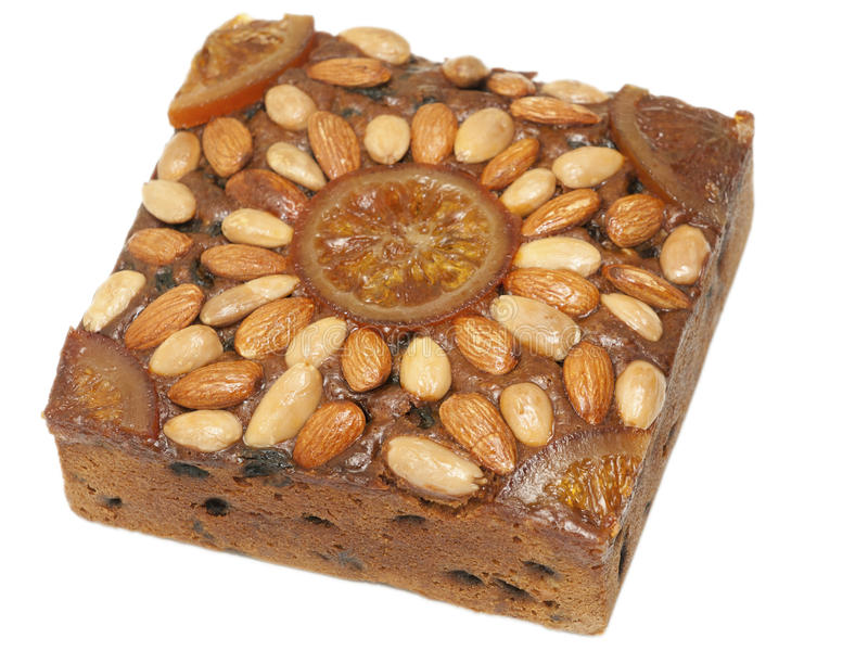 Festive treat - Dundee cake against white royalty free stock photography