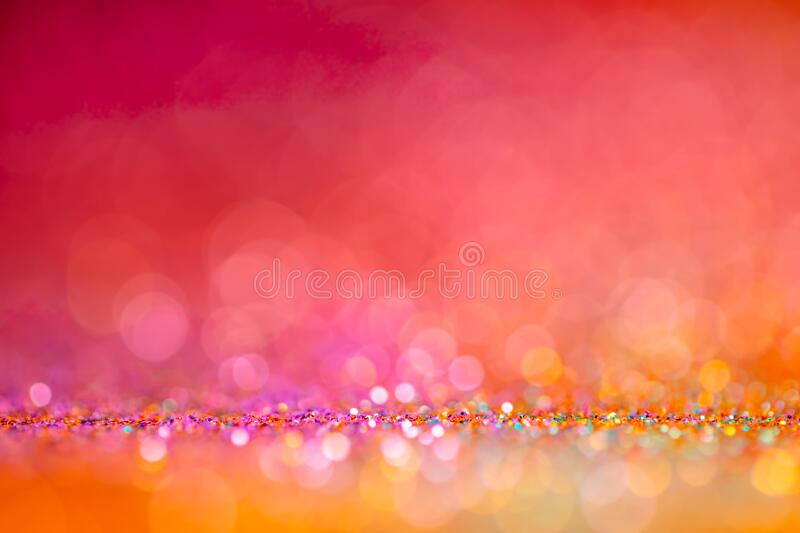 Festive twinkle lights background, abstract glowing backdrop with circles,modern design overlay with sparkling glimmers. Red, orange and pink backdrop stock image