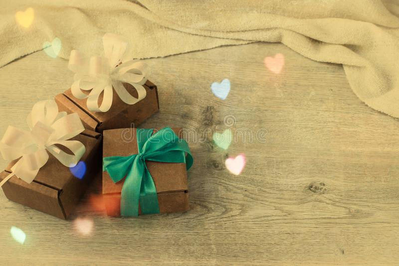 Festive vintage background boxes with gifts on wooden background. Festive effects top View Flat lay royalty free stock images