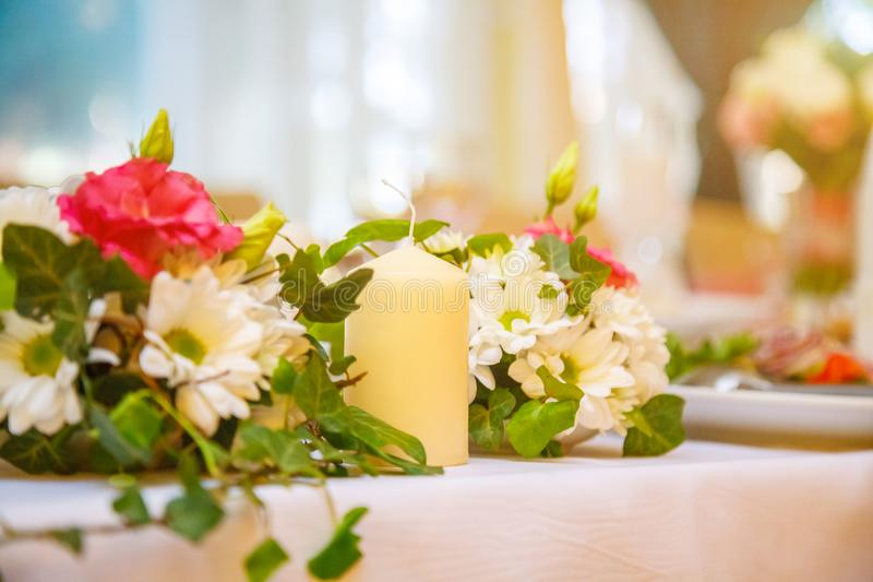 Festive wedding decor, candles and flowers royalty free stock photos