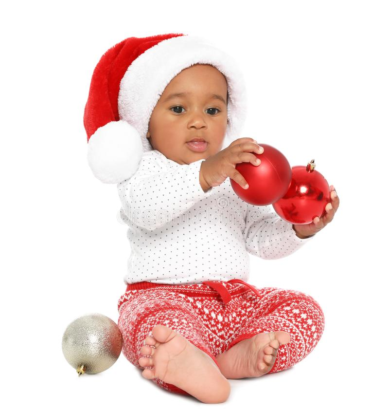 Festively dressed African-American baby with Christmas decorations on background royalty free stock images