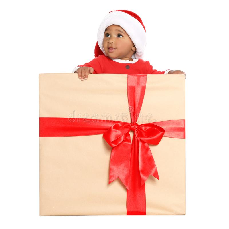 Festively dressed African-American baby in Christmas gift box on background royalty free stock photos