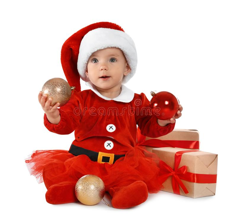 Festively dressed baby with gift boxes on white. Christmas celebration royalty free stock images
