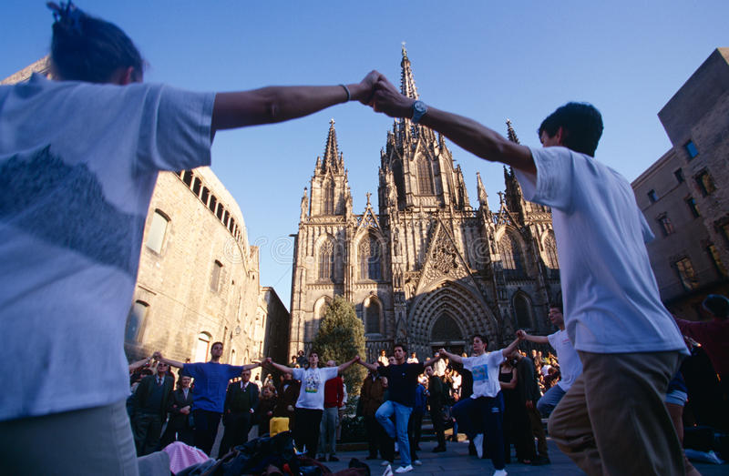 Festivites outside the Cathedral of Santa Eulalia. Festivities outside the Cathedral of Santa Eulalia in Barcelona, Spain. A group of people dancing in a circle stock photo