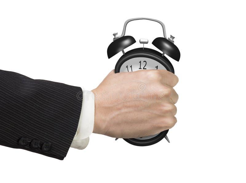 Festklemmen des Zeitkonzeptes Mannhand, die Wecker hält lizenzfreie stockfotografie