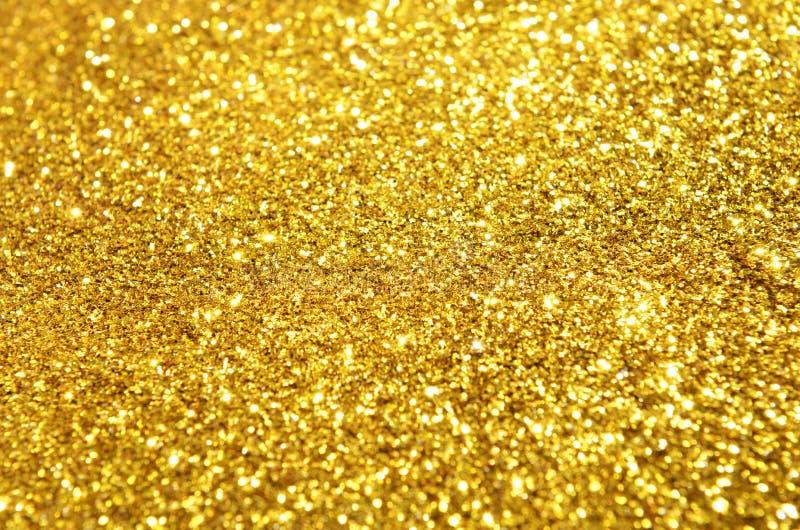 Festlicher Goldfunkelnhintergrund stockfoto