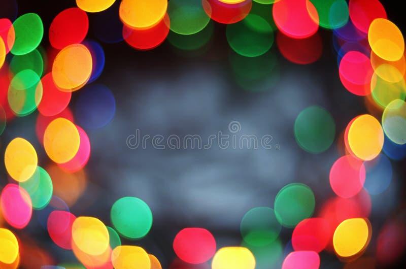 festlig bakgrund av färgrika glödande cirklar arkivfoto