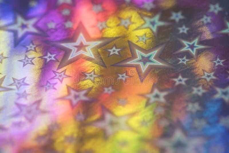 Festlig rosa blå orange metallstjärnabakgrund arkivfoton