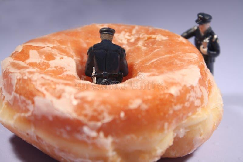 festliga donutspolisar royaltyfri bild