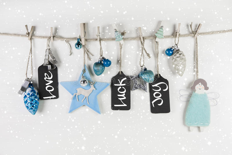 Festligt julkort i ljus - blått och vit färgar med text royaltyfri fotografi