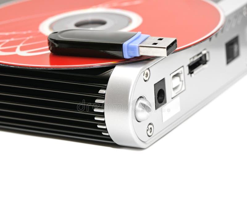 Festplatte, Flash-Speicher und Computerscheibe stockbild