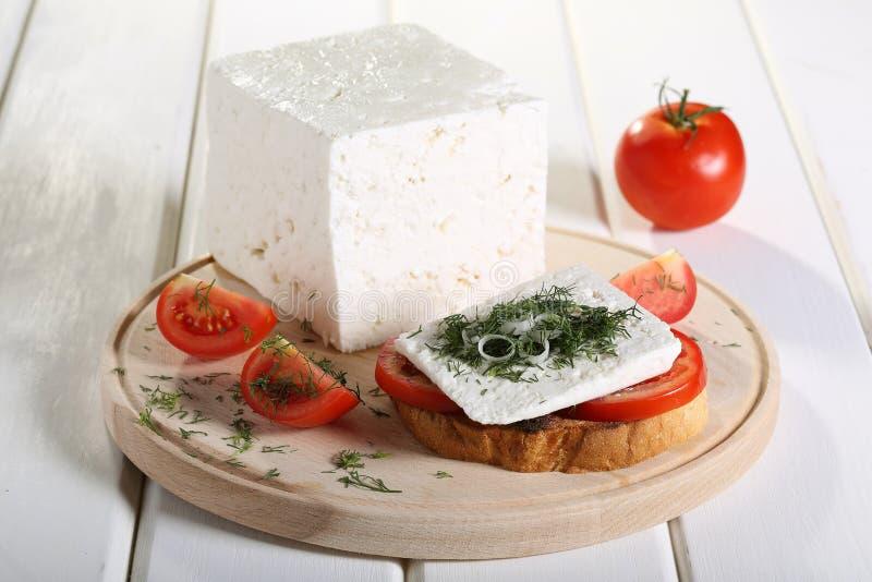 Feta-Kaas met tomaat op toost stock fotografie