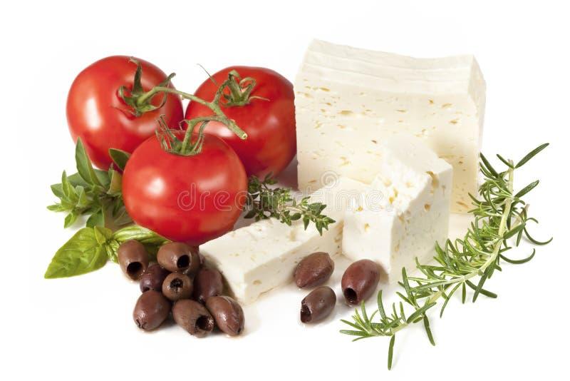 Feta, tomates, olives et herbes photographie stock
